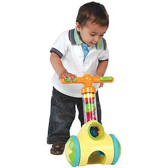 Toddler walking with toy