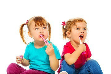 Toddlers brushing teeth