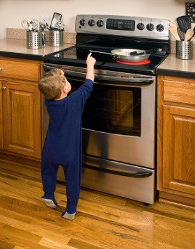 Child touching oven